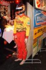 Addendum Item - Authentic race worn Sterling Marlin Nascar driver suit with helmet. - Front 3/4 - 129614