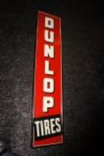 Addendum Item - Very clean Late 1950s Dunlop Tires self framed vertical tin sign. - Front 3/4 - 145293