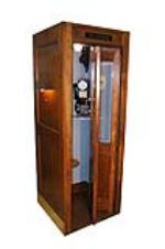Nicely restored 1930s Bell Telephone wooden telephone booth complete with pay phone and working interior lights. - Front 3/4 - 154590