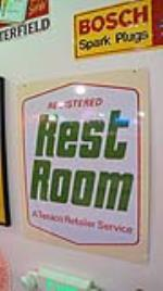 N.O.S. Texaco Clean Rest Rooms double-sided tin service station sign. - Front 3/4 - 178733