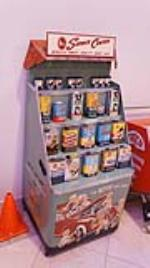 Nifty 1950's Whiz Automotive Products automotive garage metal product display filled with period tins. - Front 3/4 - 178804