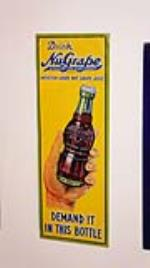 N.O.S. 1928 Nu Grape Soda tin push plate sign with hand/bottle graphic. - Front 3/4 - 178820