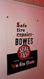 N.O.S. 1940's-50's Bowes Seal Fast Tire Repairs singe-sided embossed tin sign. - Front 3/4 - 178918