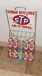 Choice 1960's STP additive rack filled with ten period cans. - Front 3/4 - 179053