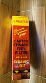 1950's Carter Carburetor ceramic fuel filter automotive garage tin display still full of product. - Front 3/4 - 179081