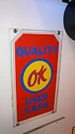 1960's Chevrolet OK Quality Used Cars double-sided tin sign. - Front 3/4 - 179324