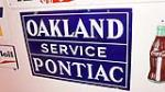 1930's Oakland Pontiac Service double-sided porcelain dealership sign. - Front 3/4 - 179388