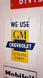 N.O.S. late 1950's-early 60's We Use GM-Chevrolet Genuine Parts double-sided tin sign. - Front 3/4 - 179390
