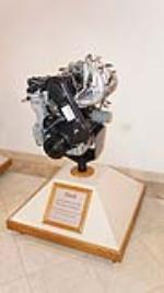 Ford Four Cylinder 1.6 Liter 98 Cubic Inch engine on stand. - Front 3/4 - 179409