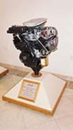 "Ford Eight Cylinder 427 Cubic Inch ""Big"" Block High Performance V-8 Engine on stand. - Front 3/4 - 179410"