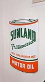 1950's N.O.S. Sunland Motor Oil single-sided porcelain quart shaped service station sign. - Front 3/4 - 179418