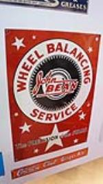 1950's john Bean Wheel Balancing Service single-sided tin automotive garage sign. - Front 3/4 - 179426