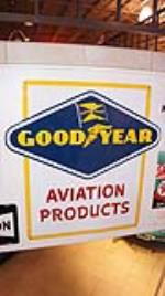N.O.S. 1957 Goodyear Aviation Products single-sided tin airport hanger sign. - Front 3/4 - 179441