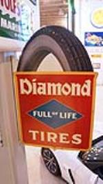 Museum quality 1920's Diamond Tires double-sided die-cut tin garage sign - Front 3/4 - 179449