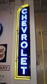 Chevrolet Automobiles single-sided neon porcelain dealership sign. - Front 3/4 - 179474