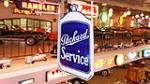 Exceptional 1930's Packard Automobiles double-sided radiator shaped porcelain sign with original hanging bracket. - Front 3/4 - 179484