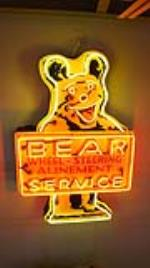 1950's Bear Wheel Alignment Service single-sided neon tin bear shaped automotive garage sign. - Front 3/4 - 179869