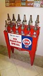 Nicely restored 1930's RPM Motor Oil service station 12 bottle oil rack complete with period bottles. - Front 3/4 - 179920