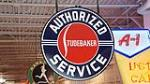 Very clean 1950's Studebaker Authorized Service double-sided porcelain dealership sign. - Front 3/4 - 180262