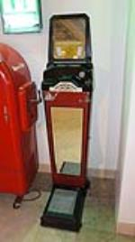 Circa 1940's Watling Fortune Teller coin-operated penny scale found in all original condition. - Front 3/4 - 180297