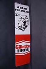 Fantastic NOS Gillette Tires single-sided vertical tin sign with bear graphic. - Front 3/4 - 191961