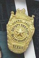Johnny Cash pin badge issued by the Bexar County to show Cash as a deputy Sheriff - Front 3/4 - 46309
