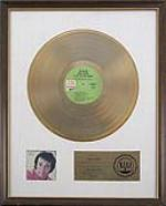 Herb Alpert gold record A RIAA certified sales award to commemorate the sale of over one million dollars worth of the album Warm, presented to Alpert. Mounted, framed and glazed. - 46470