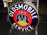 Choice 1940s Oldsmobile Service double-sided porcelain dealership sign. - Front 3/4 - 47131