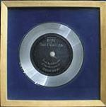 The Beatles platinum record presented for their UK number 1 hit Twist and Shout, 1963. - Front 3/4 - 47847