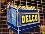 Fabulous N.O.S. 1950s Delco Batteries die-cut tin batteries sign. - Front 3/4 - 48246