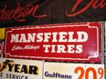 Near perfect N.O.S. Mansfield Tires embossed tin garage sign. - Front 3/4 - 67274
