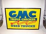 """N.O.S. 1930s GMC """"triple Checked"""" Used Truck tin painted wood framed dealership sign. - Front 3/4 - 71493"""