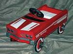 Early 1960s restored Parkleigh pedal car with upholstered seat. - Front 3/4 - 74062