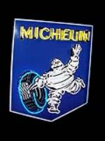 Impressive 1950s Michelin Tires single-sided porcelain neon garage sign featuring Bibedum. - Front 3/4 - 93891