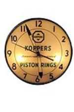 1950s-60s Koppers American Hammered Piston Rings glass faced light up garage clock. - Front 3/4 - 94018